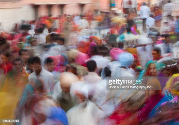 blurred scene of busy indian street, rajasthan, india - india market stock photos and pictures