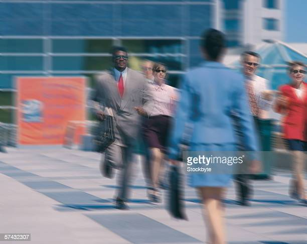 blurred shot of business executives in a hurry