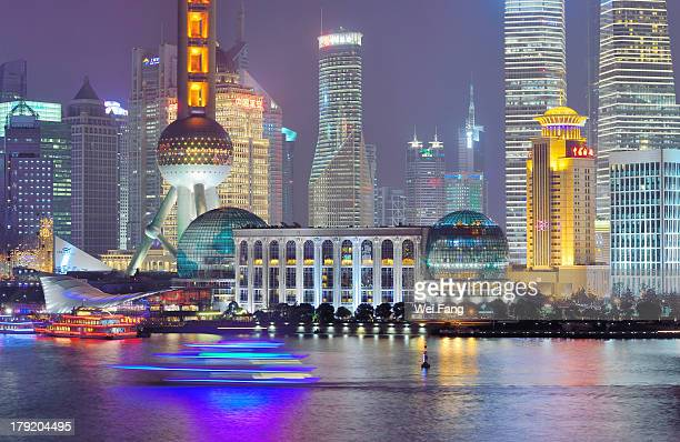 Blurred sightseeing cruise in the Huangpu River against the night skyline of Shanghai's Lujiazui Financial District.The landmark of Oriental Pearl TV...