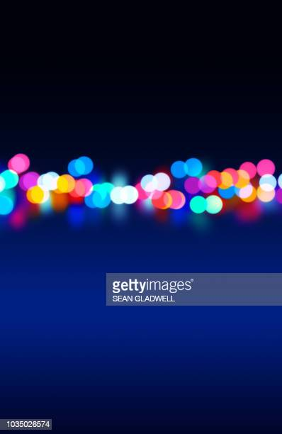 blurred street lights at night - lighting equipment stock photos and pictures
