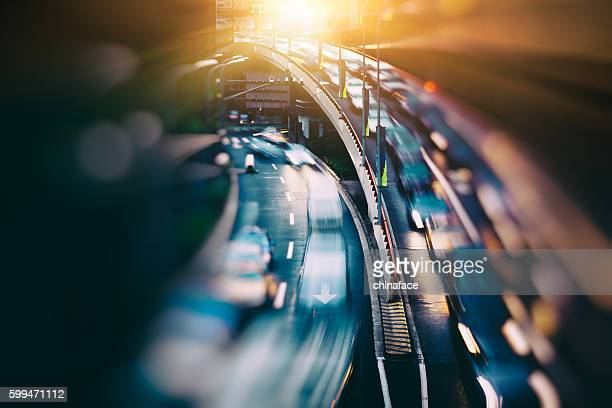 blurred traffic  in central district - traffico foto e immagini stock