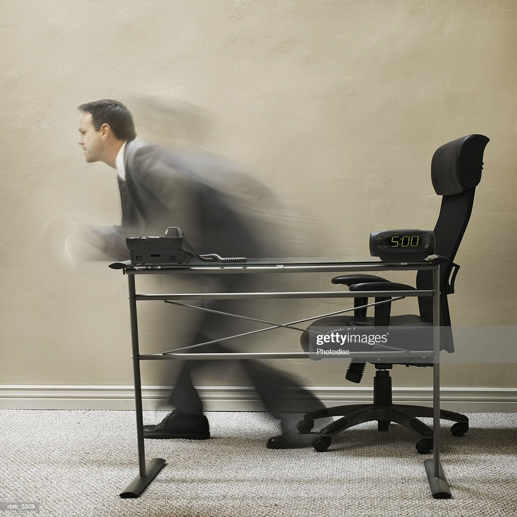 Blurred view of a businessman getting up from a chair : Foto de stock