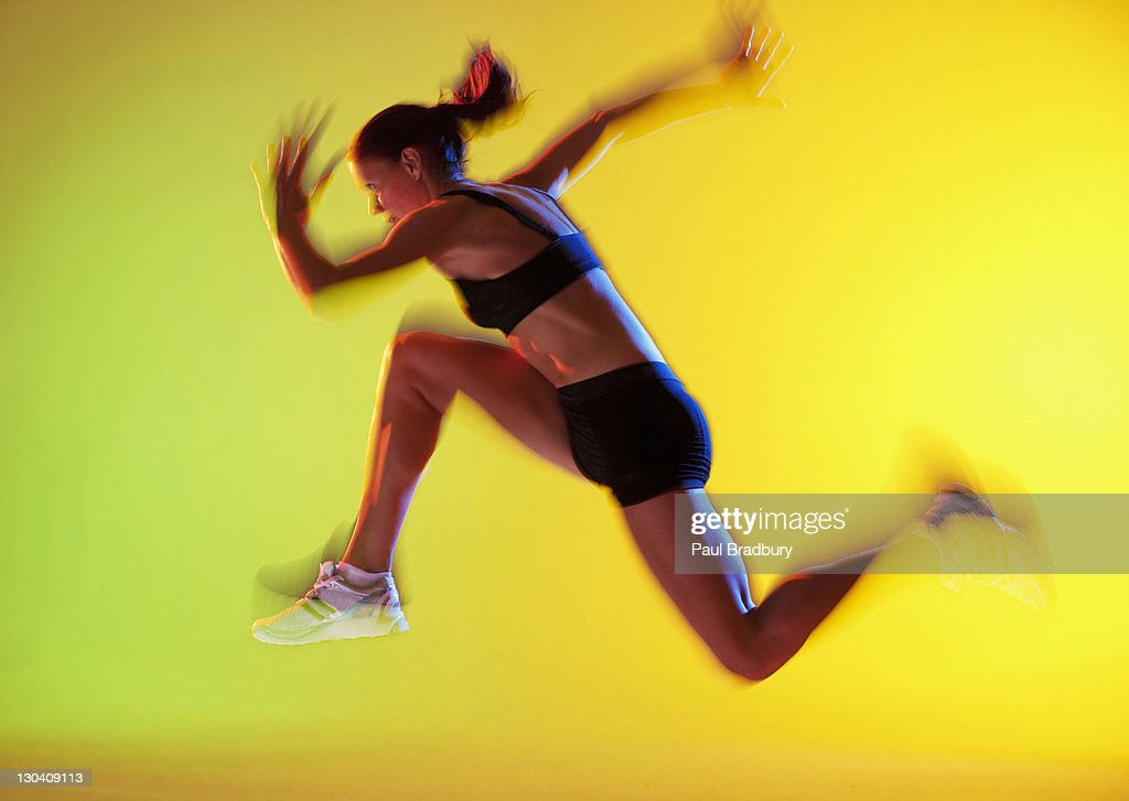 Blurred view of athlete running : Stock Photo