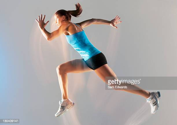 blurred view of athlete running - extra long stock pictures, royalty-free photos & images