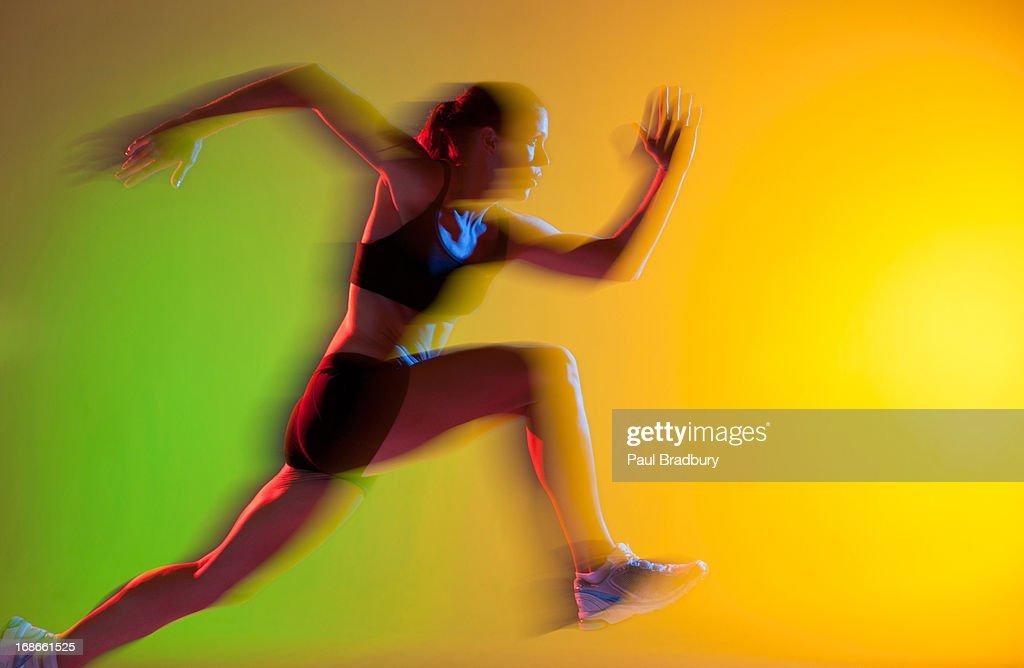 Blurred view of athlete running : Stock Photo