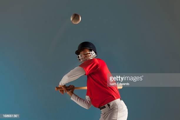 Blurred view of baseball player swinging bat