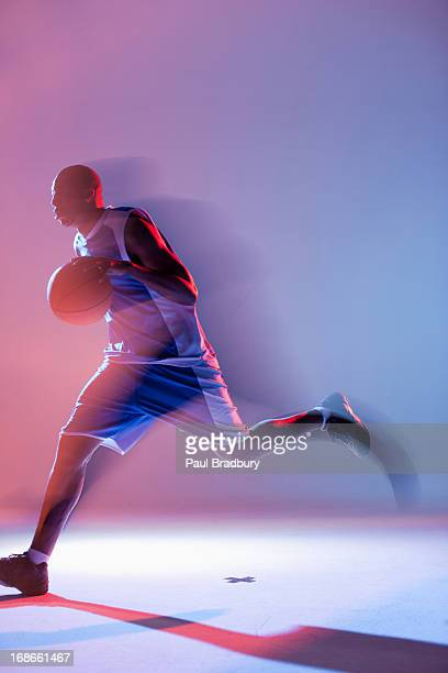 blurred view of basketball player dribbling - dribbling sports stock pictures, royalty-free photos & images