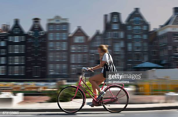 Blurred view of bicyclist on Amsterdam street, Netherland