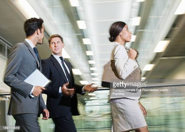 Blurred view of business people walking in office