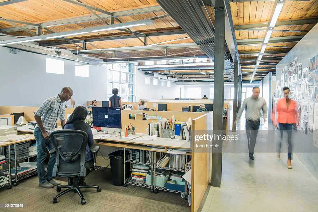 Blurred view of business people walking in office : Stock Photo