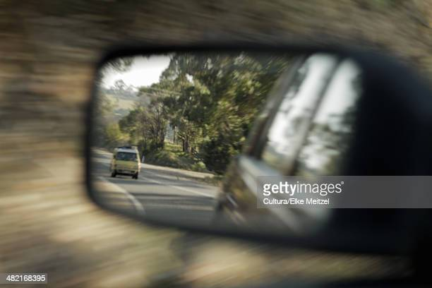 blurred view of car in side mirror - following stock pictures, royalty-free photos & images