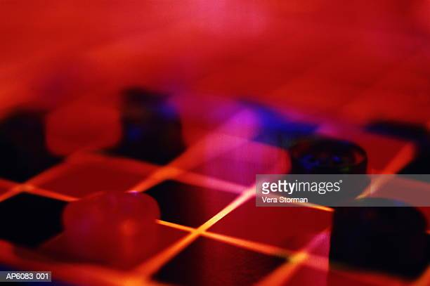 Blurred view of checker board under distorted red light