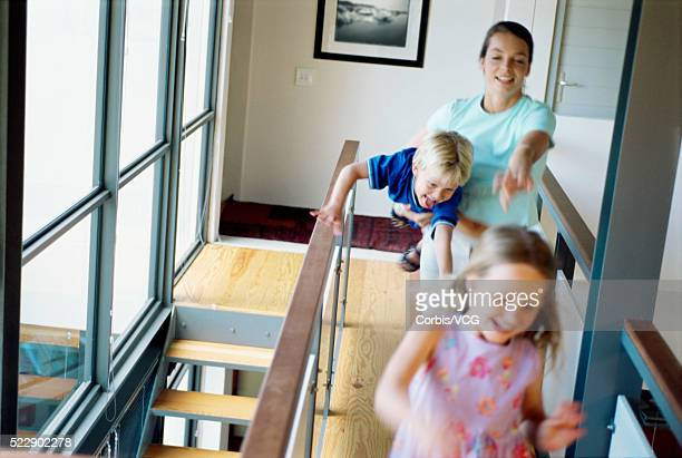 Blurred view of children running away from their mother