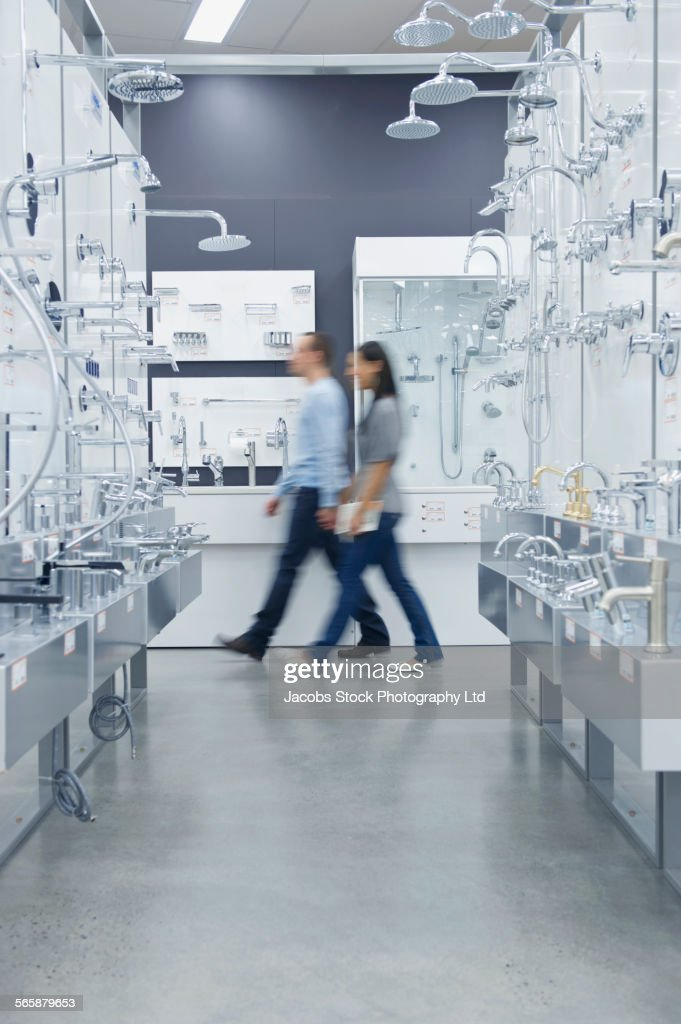 Blurred View Of Couple Shopping For Bathroom Fixture In Store Stock ...