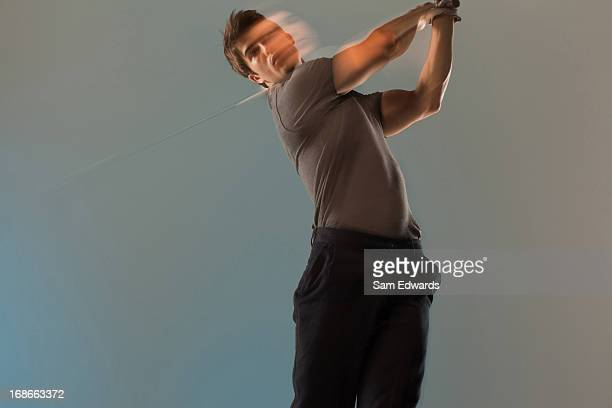blurred view of golf player swinging club - sam's club stock pictures, royalty-free photos & images