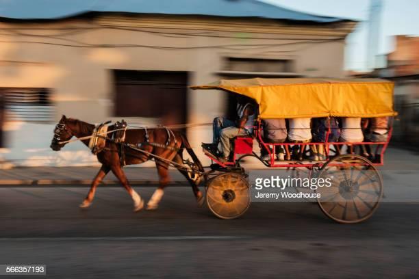 Blurred view of horse drawn taxi on Santiago de Cuba street, Santiago, Cuba