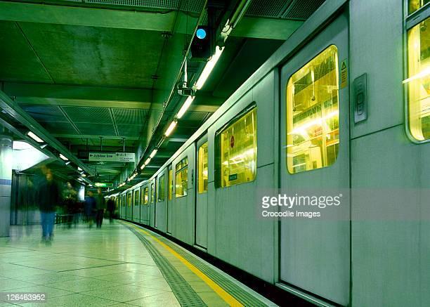 Blurred view of people at railway platform