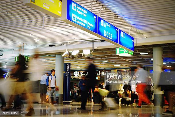 blurred view of people walking at airport terminal - frankfurt international airport stock pictures, royalty-free photos & images