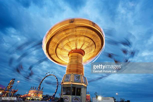 blurred view of ride at amusement park - canadian national exhibition stock photos and pictures