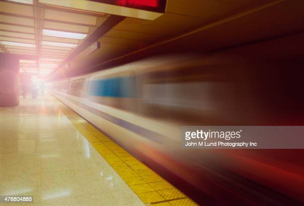 Blurred view of train leaving platform