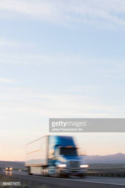 Blurred view of truck driving on remote highway