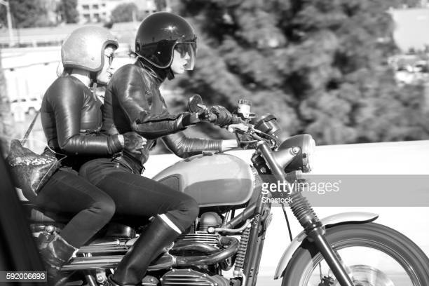 blurred view of women riding motorcycle - women black and white motorcycle stock pictures, royalty-free photos & images