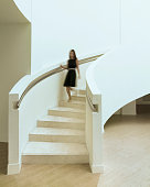 Blurred woman walking down staircase