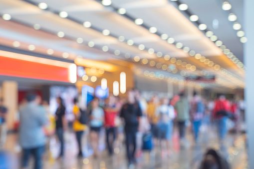 Blurred,defocused background of Crowd in trade event exhibition hall. Business trade show,shopping mall and marketing advertisement concept,MICE industry business concept 1153317454