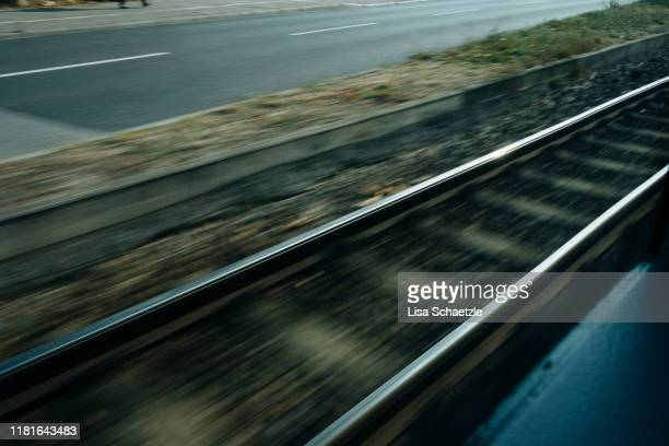 blurried rails – urban street scene - lisa strain stock pictures, royalty-free photos & images