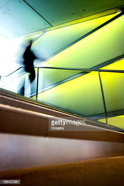 Blurry figure waking down a set of modern stairs