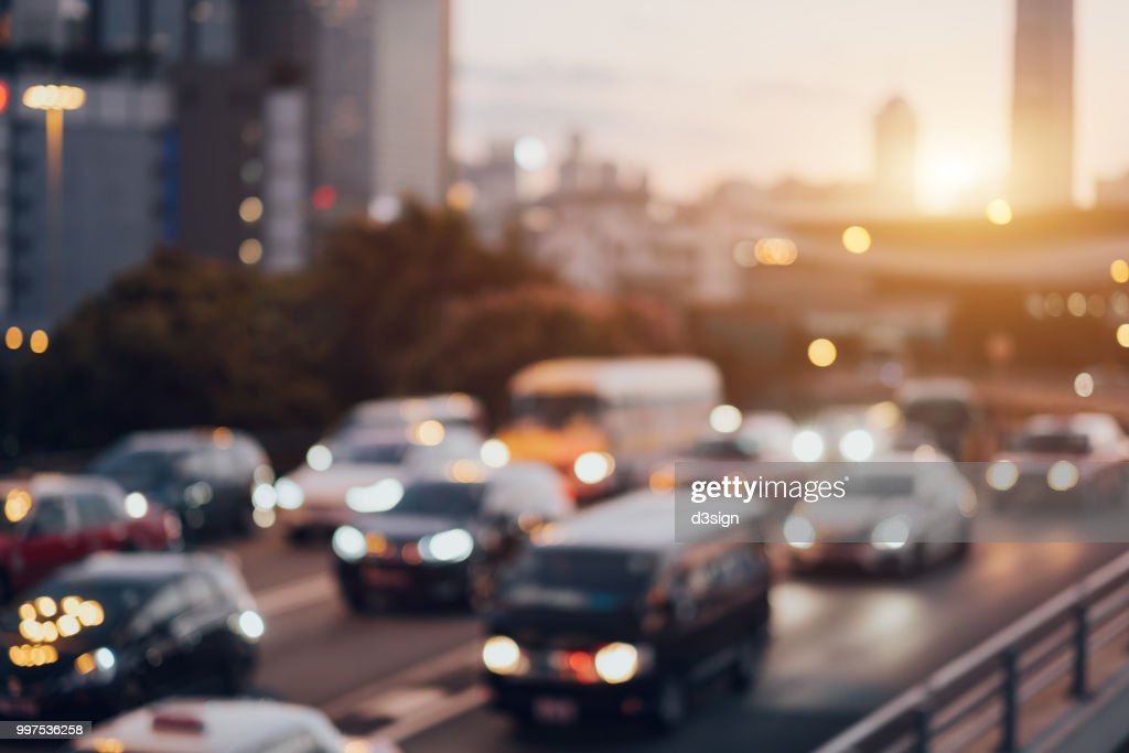 Blurry image of rush hour traffic on busy highway at sunset : Stock Photo