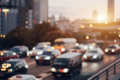 Blurry image of rush hour traffic on busy highway at sunset - gettyimageskorea