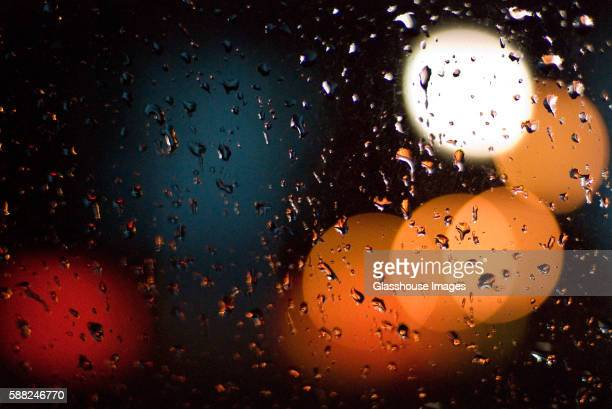 blurry lights and rain on window - soft focus stock pictures, royalty-free photos & images