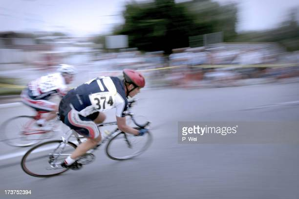 Blurry photo of two men in a bicycle race