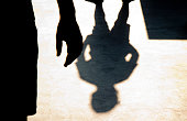 Blurry shadow silhouette of two boys confronting each other