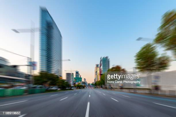 blurry teheran-ro street in gangnam station - avenue stock pictures, royalty-free photos & images