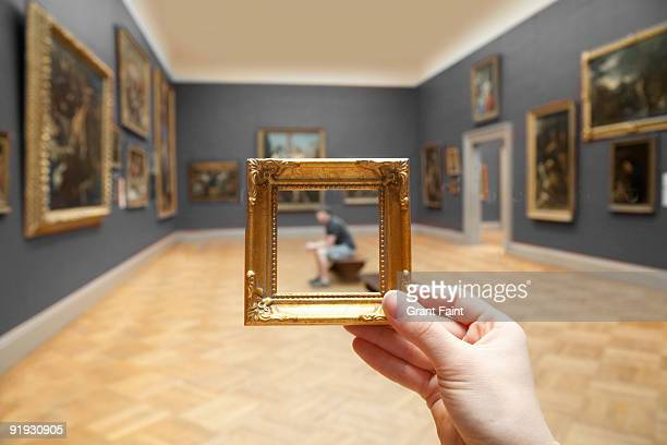 blurry young man framed by small golden frame - met art gallery fotografías e imágenes de stock