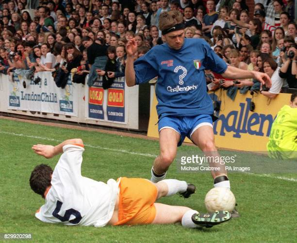 Blur's lead singer Damon Albarn is tackled during this afternoon's Music Industry Soccer Six '97 tournament at Fulham FC Photo by Michael Crabtree/PA
