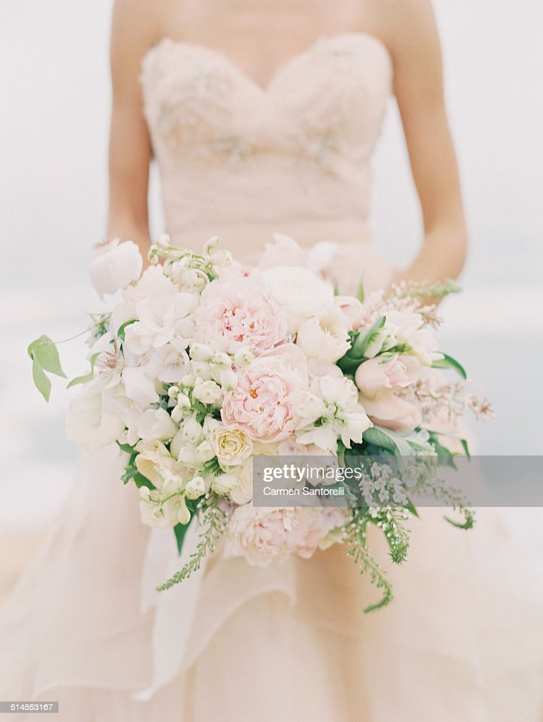 Blush Bridal Bouquet Held By A Bride High Res Stock Photo Getty