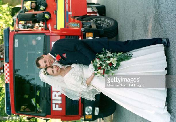 Blushing bride Michelle Dodd and groom Colin O'Loughlin after the Chester firemen saved their wedding day by giving the bride a lift after the...