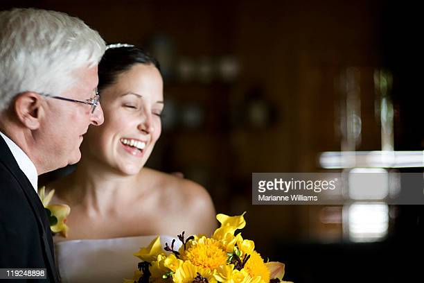 Blushing bride with her father on her wedding day