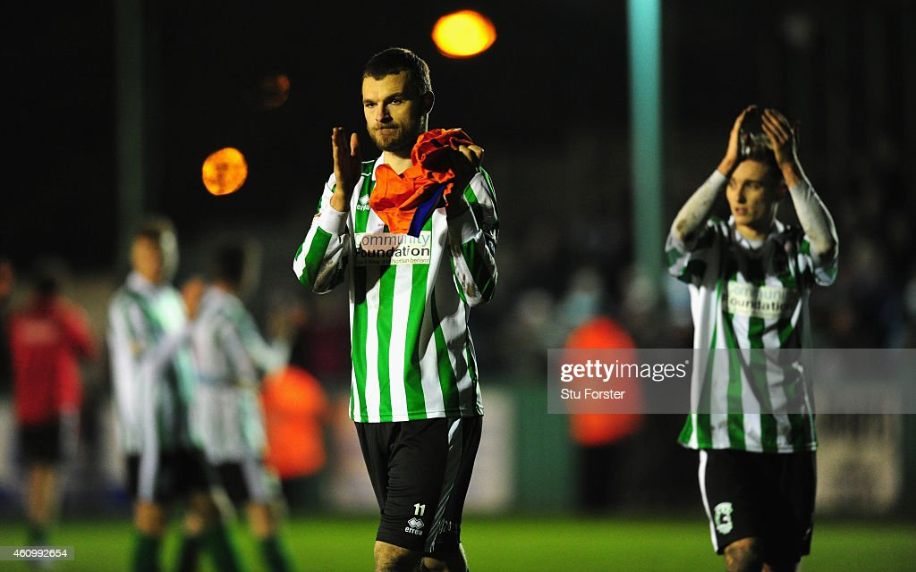 Blyth captain Robert Dale (l) Jarrett Rivers (r)applaud the crowd after the FA Cup Third Round match between Blyth Spartans and Birmingham City at Croft Park on January 3, 2015 in Blyth, England.
