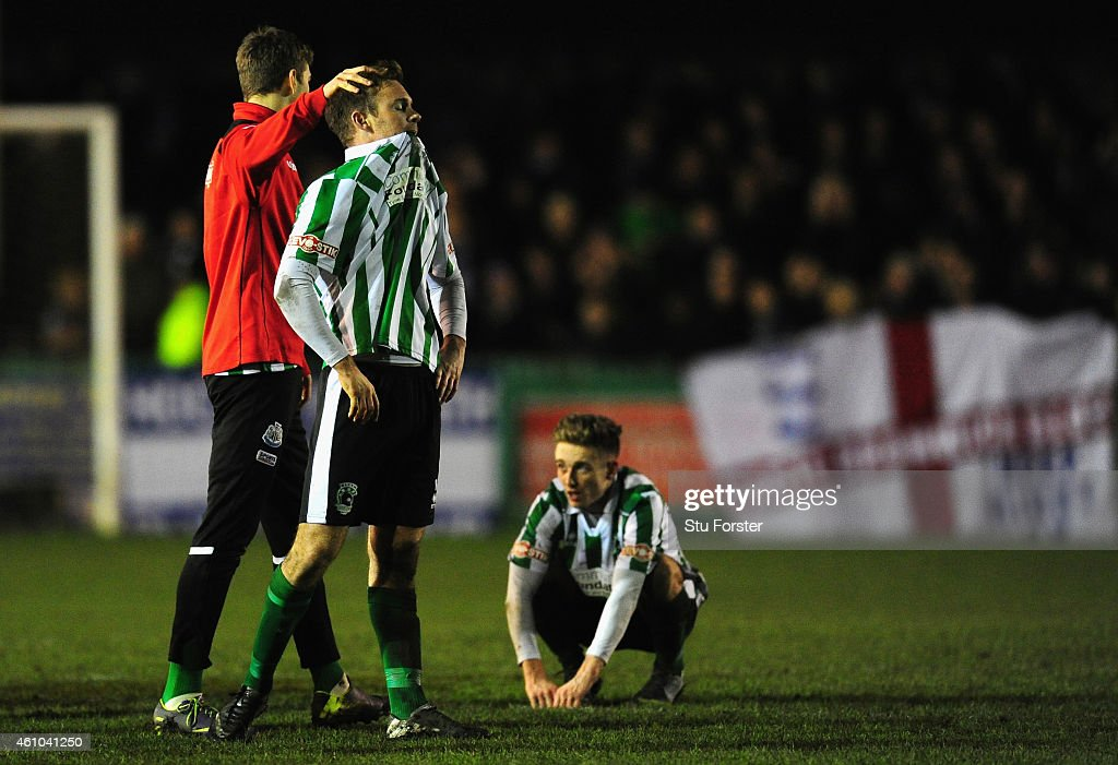 Blyth player Stephen Turnball (l) is consoled as Jarrett Rivers (r) looks on after the FA Cup Third Round match between Blyth Spartans and Birmingham City at Croft Park on January 3, 2015 in Blyth, England.