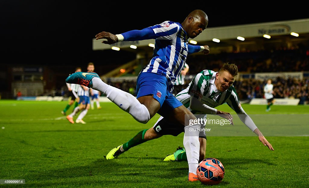 Blyth Spartans player Ryan Hutchinson (r) is challenged by Marlon Harewood of Hartlepool during the FA Cup Second round match between Hartlepool United and Blyth Spartans at Victoria Park on December 5, 2014 in Hartlepool, England.