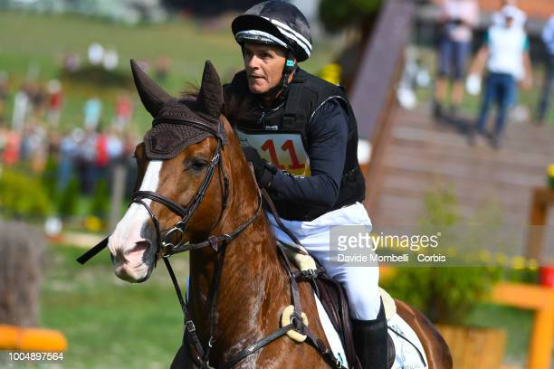 Blyth Tait of New Zealand riding Havanna during the obstacle in the water of the Cross Country test DHLPrize in the park of the CHIO of Aachen on...