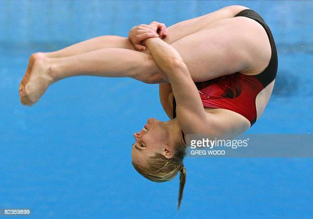 Blythe Hartley of Canada performs during the women's 3m springboard diving preliminary at the National Aquatics Center at the 2008 Beijing Olympic...