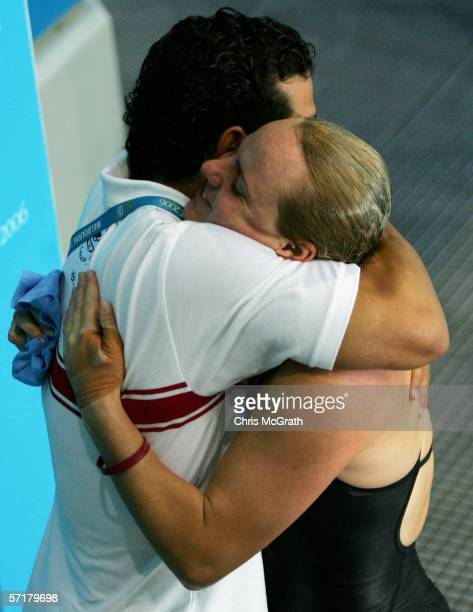 Blythe Hartley of Canada receives congratulations as she wins gold in the Women's 3m Springboard Final during the diving at the Melbourne Sports...