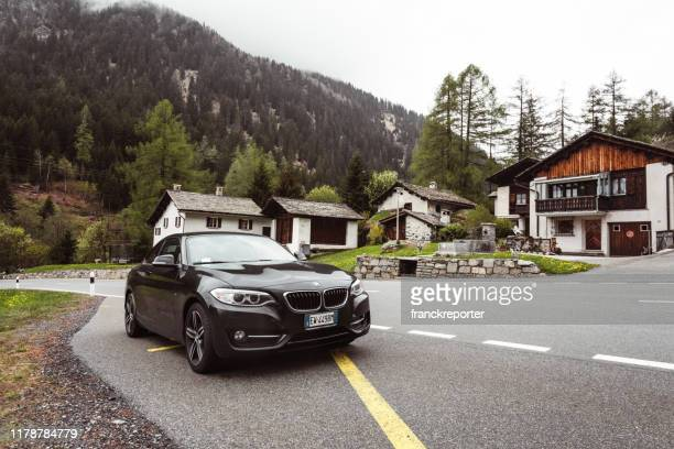 bmw 220d parked along the road in switzerland - bmw stock pictures, royalty-free photos & images