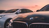 bmw car on sunset sky.