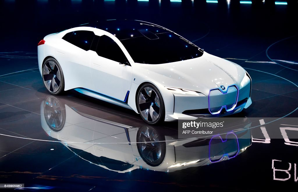 A BMWi Vision Dynamic all-electric concept car is presented on stage during a show at the stand of German carmaker BMW at the Frankfurt Motor Show IAA in Frankfurt am Main, western Germany, on September 12, 2017. According to organisers, around 1,000 exhibitors from 39 countries will showcase their products and services. This year's fair running from September 14 to 24, 2017 will focus on digitization, urban mobility and electric mobility. / AFP PHOTO / Tobias SCHWARZ